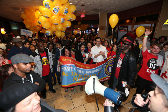 Demonstrators participate during a Fight For $15 rally inside McDonald's at The D Las Vegas casino-hotel Tuesday, Nov. 10, 2015 in Las Vegas. Fast food workers and supporters demand for a $1 ...