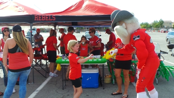 UNLV's mascot Hey Reb greets people partaking in last years tailgate party on Oct. 10 2014 that marked the culmination of the sesons Plastic Food Drive benefitting the Nevada Partnership for ...
