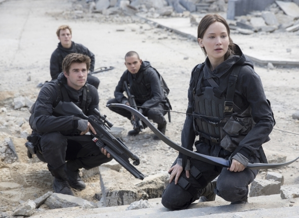 """Gale Hawthorne (Liam Hemsworth, front left), Finnick Odair (Sam Claflin, back left), Messalla (Evan Ross, back right) and Katniss Everdeen (Jennifer Lawrence, front right) in """"The Hunger Game ..."""