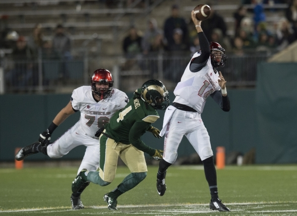 UNLV quarterback Kurt Palandech sends the ball deep down the field during the fourth quarter in a game against CSU at Hughes Stadium in Fort Collins, Colo. Saturday, November 14, 2015. The Rebels  ...
