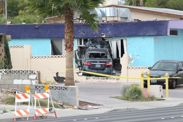 A vehicle crashed into an unoccupied house at 1657 Desert Inn Road about 7 a.m. Tuesday, Nov. 10, 2015. Bizuayehu Tesfaye/Las Vegas Review-Journal Follow @bizutesfaye