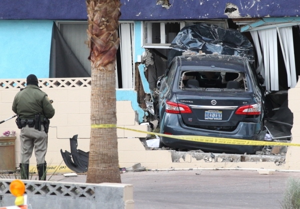 A Metro police officer investigates after a vehicle crashed into an unoccupied house at 1657 Desert Inn Road about 7 a.m. Tuesday, Nov. 10, 2015. BIZUAYEHU TESFAYE/LAS VEGAS REVIEW-JOURNAL / FOLLO ...