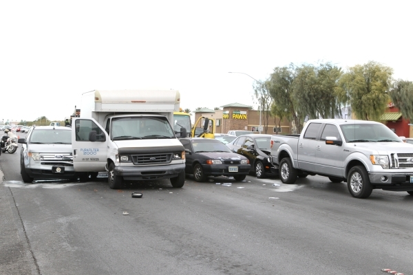 Two people were hospitalized after a multivehicle crash at Rancho Drive and Smoke Ranch Road, Tuesday, Oct. 10, 2015. Bizuayehu Tesfaye/Las Vegas Review-Journal Follow @bizutesfaye