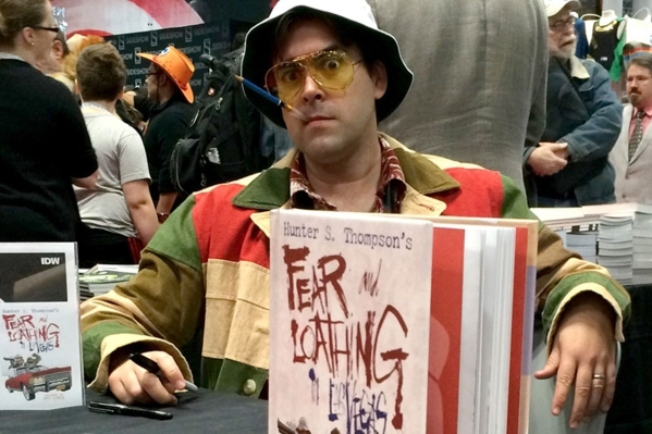 """Artist Troy Little, dressed as Hunter S. Thompson, signs copies of his graphic novel adaptation of """"Fear and Loathing in Las Vegas"""" at the New York Comic-Con. (Courtesy Topshelf Productions)"""