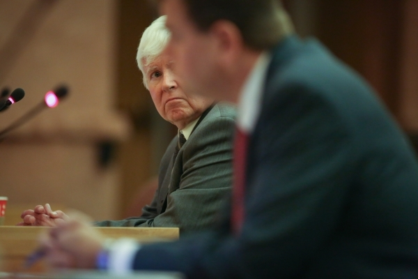 Ombudsman Terry Jackson, background, looks at Chief Deputy District Attorney Tim Fettig at the public fact finding review of the shooting of John Allen which took place at the Clark County Governm ...