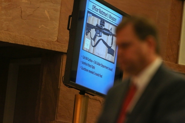 A weapon that was used to kill John Allen is shown on a monitor at the public fact finding review of the shooting which took place at the Clark County Government Center Commission Chambers on Frid ...