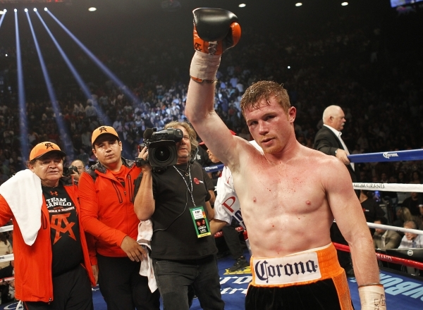 Saul Canelo Alvarez celebrates after defeating Erislandy Lara during their Super Welterweight fight at the MGM Grand Garden Arena in Las Vegas on Saturday, July 12, 2014.(Jason Bean/Las Vegas Revi ...