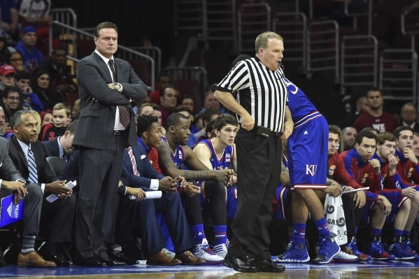 Dec 22, 2014; Philadelphia, PA, USA; Kansas Jayhawks head coach Bill Self watches from the sideline during the first half of the game against the Temple Owls at the Wells Fargo Center. Mandatory C ...