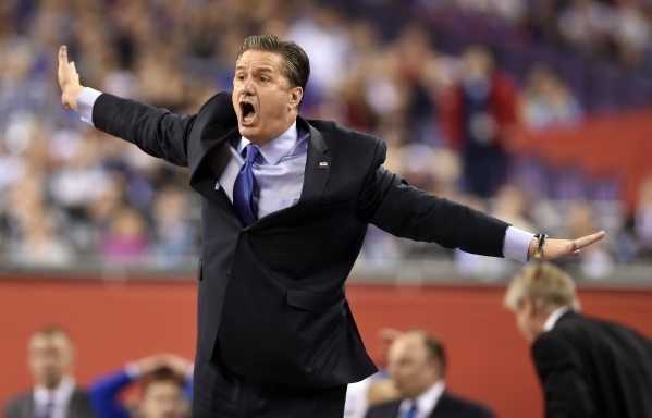 Apr 4, 2015; Indianapolis, IN, USA; Kentucky Wildcats head coach John Calipari reacts against the Wisconsin Badgers in the second half of the 2015 NCAA Men's Division I Championship semi-fin ...