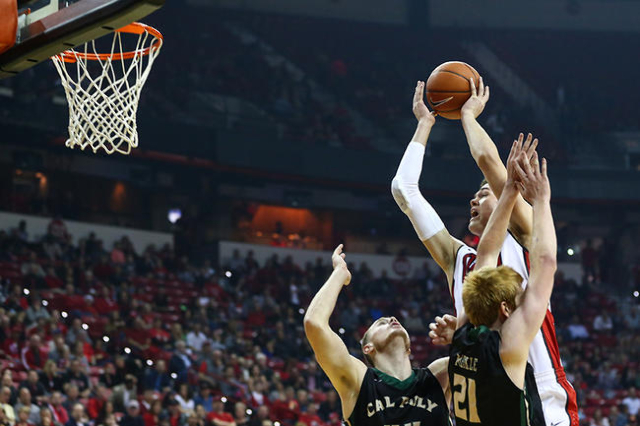 UNLV's Stephen Zimmerman (1) dunks the ball over Cal Poly's Luke Melkie (21) and Zach Gordon (44) during a basketball game at the Thomas & Mack Center in Las Vegas on Friday, Nov.  ...