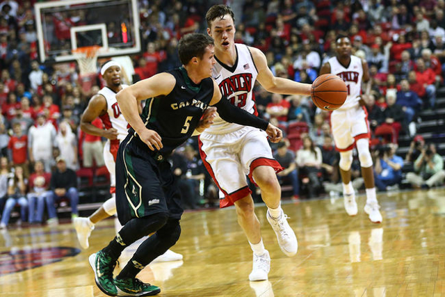 UNLV's Stephen Zimmerman (1) is fouled by Cal Poly's Reese Morgan (5) during a basketball game at the Thomas & Mack Center in Las Vegas on Friday, Nov. 13, 2015. Chase Stevens/Las  ...
