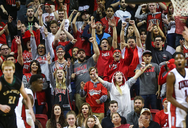 UNLV fans cheer after the team scored against Cal Poly during a basketball game at the Thomas & Mack Center in Las Vegas on Friday, Nov. 13, 2015. Chase Stevens/Las Vegas Review-Journal Follow ...