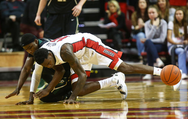 UNLV's Dwayne Morgan trips up while playing against Cal Poly during a basketball game at the Thomas & Mack Center in Las Vegas on Friday, Nov. 13, 2015. Chase Stevens/Las Vegas Review-Jo ...