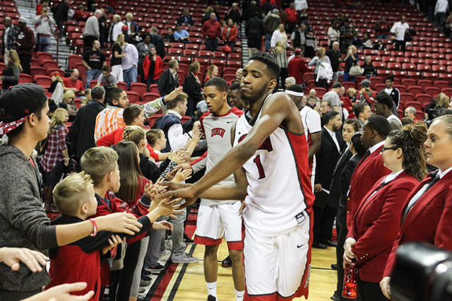 UNLV's Derrick Jones Jr. high-fives fans after defeating Cal Poly in a basketball game at the Thomas & Mack Center in Las Vegas on Friday, Nov. 13, 2015. Chase Stevens/Las Vegas Review-J ...