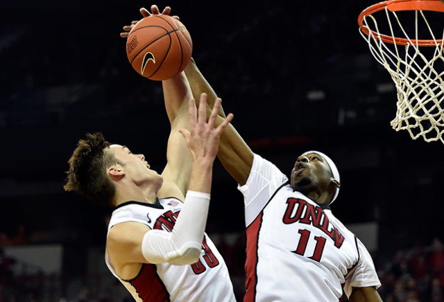 UNLV's Stephen Zimmerman Jr. (33) and Goodluck Okonoboh (11) grabs a rebound against Cal Poly during a NCAA basketball game at the Thomas & Mack Center in Las Vegas Friday, Nov. 13, 2015 ...