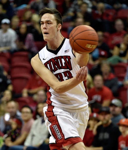 UNLV forward Stephen Zimmerman Jr. (33) passes against Cal Poly during a NCAA basketball game at the Thomas & Mack Center in Las Vegas Friday, Nov. 13, 2015. UNLV won 74-72. David Becker/Las V ...