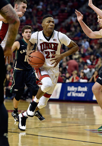 UNLV guard Patrick McCaw (22) drives to the basket against Cal Poly during a NCAA basketball game at the Thomas & Mack Center in Las Vegas Friday, Nov. 13, 2015. UNLV won 74-72. David Becker/L ...