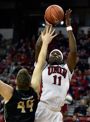 UNLV center Goodluck Okonoboh (11) shoots over Cal Poly's Zach Gordon during a NCAA basketball game at the Thomas & Mack Center in Las Vegas Friday, Nov. 13, 2015. UNLV won 74-72. David  ...