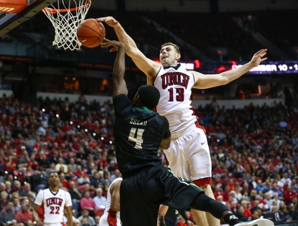 UNLV's Ben Carter (13) blocks a shot by Cal Poly's Jaylen Shead (4) during a basketball game at the Thomas & Mack Center in Las Vegas on Friday, Nov. 13, 2015. Chase Stevens/Las Ve ...
