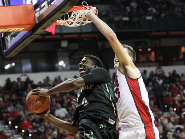 UNLV's Stephen Zimmerman (33) looks to block a shot from Cal Poly's David Nwaba (0) during a basketball game at the Thomas & Mack Center in Las Vegas on Friday, Nov. 13, 2015. Chas ...