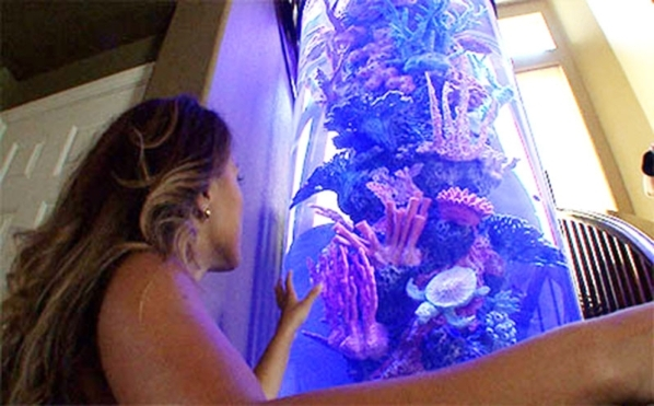 Melissa Victorino shows off her home's fish.  KEITH DAVIS/REAL ESTATE MILLIONS