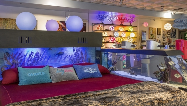"Eric Yugar, owner of Holy Sheets, had ""Tanked"" hosts  Wayde King and Brett Raymer build a custom aquarium into a bed as a showcase for his store. COURTESY"