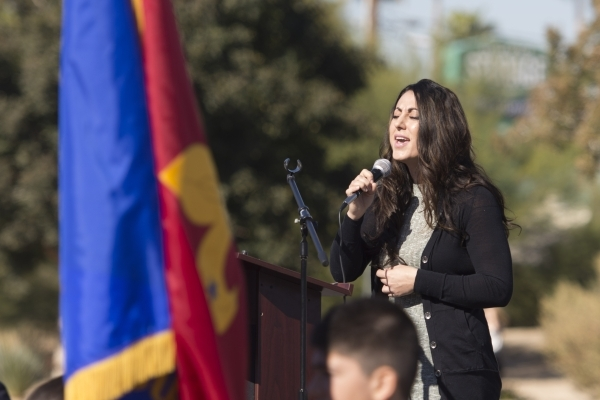 Maral Saccoyan sings the Armenian and American national anthems during the unveiling and dedication of the Armenian Genocide Memorial Monument in Sunset Park in Las Vegas Saturday, Nov. 14, 2015.  ...