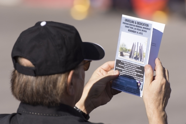A man views the program during the unveiling and dedication of the Armenian Genocide Memorial Monument in Sunset Park in Las Vegas Saturday, Nov. 14, 2015. Jason Ogulnik/Las Vegas Review-Journal