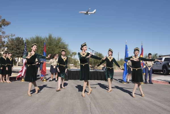 Members of the Armenian Dance School of Las Vegas perform during the unveiling and dedication of the Armenian Genocide Memorial Monument in Sunset Park in Las Vegas Saturday, Nov. 14, 2015. Jason  ...