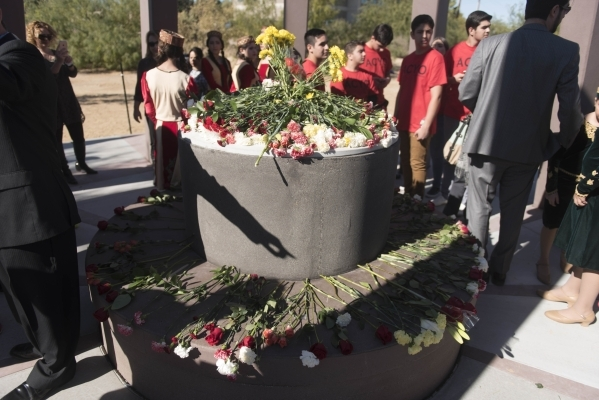 Carnation are placed on the monuments central bench during the unveiling and dedication of the Armenian Genocide Memorial Monument in Sunset Park in Las Vegas Saturday, Nov. 14, 2015. Jason Ogulni ...