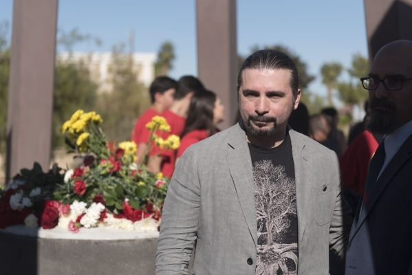 John Dolmayan, drummer for the Armenian-American band System of a Down is seen at the monument during the unveiling and dedication of the Armenian Genocide Memorial Monument in Sunset Park in Las  ...