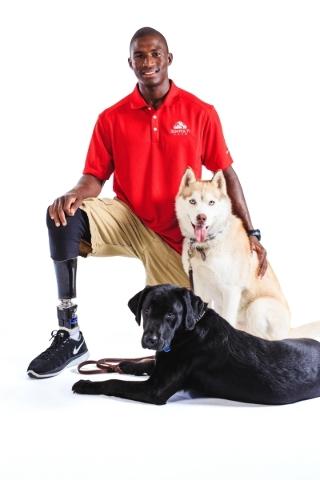 Kionte Storey poses with his service dog, a Siberian Husky named Koja. Storey credits Koja with saving his life. The black lab is a foster dog. Courtesy photo
