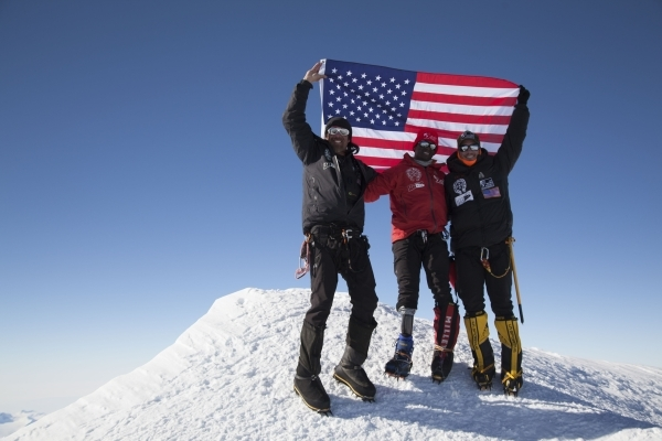Former U.S. Marine corporal Kionte Storey, center, is seen at the summit of Antartica's Mount Vinson. Storey was the first amputee to reach the summit. Courtesy photo