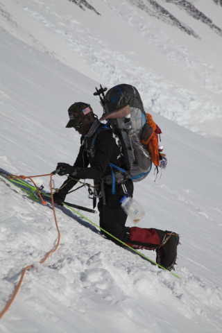 Former U.S. Marine corporal Kionte Storey makes his way across a snow field during a climb to the summit of Antartica's Mount Vinson. Storey was the first amputee to reach the summit. Courte ...