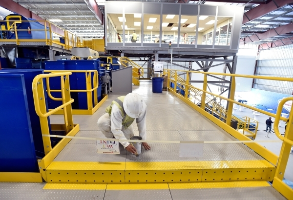 A painter touches up a catwalk at the new Republic Services recycling center before the official opening in North Las Vegas on Wednesday, Nov. 11, 2015. The $35 million facility, which is set to o ...