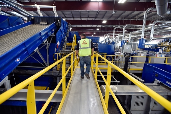 Len Christopher, general manager at Republic Services, leads a tour of the new recycling center in North Las Vegas on Wednesday, Nov. 11, 2015. The $35 million facility, which is set to open withi ...