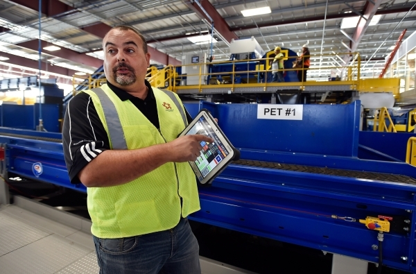 Len Christopher, general manager at Republic Services, displays a tablet that can control the new recycling center in North Las Vegas on Wednesday, Nov. 11, 2015. The $35 million facility, which i ...