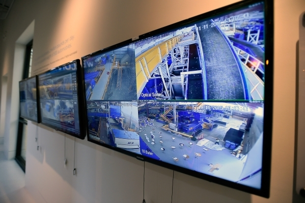 Video monitors inside the learning center at Republic Services' North Las Vegas new recycling center display machinery on Wednesday, Nov. 11, 2015. The $35 million facility, which is set to  ...