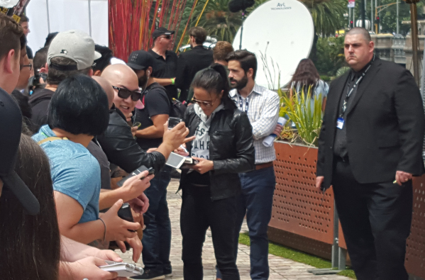 Valerie Letourneau signs autographs for fans at open workouts at Federation Square in Melbourne, Australia, in advance of her women's strawweight title fight against champion Joanne Jedrzejc ...
