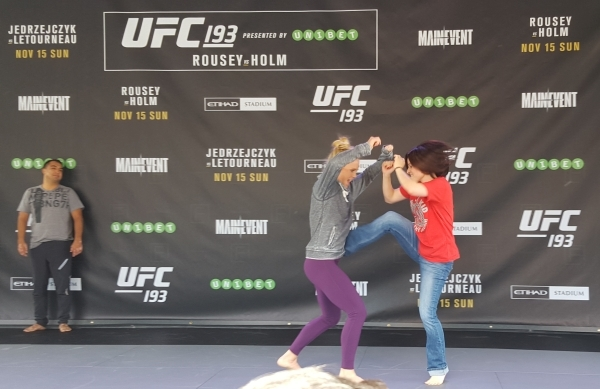 Holly Holm takes a kick from fan Kelly Ross during open workouts for UFC 193 at Federation Square in Melbourne, Australia, on Sunday. Holm will challenge Ronda Rousey for the women's bantamw ...