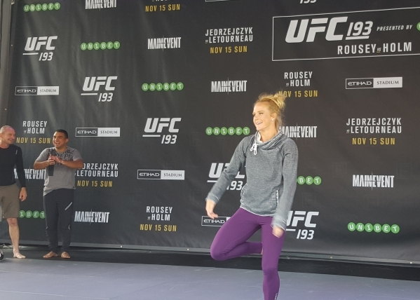 Holly Holm dances during open workouts for UFC 193 at Federation Square in Melbourne, Australia, on Sunday. Holm will challenge Ronda Rousey for the women's bantamweight title at Etihad Stad ...