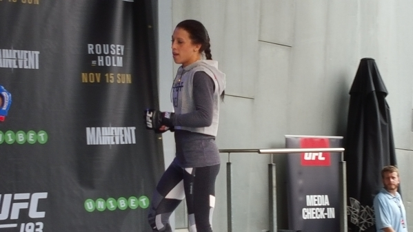 UFC women's strawweight champion Joanna Jedrzejczyk hits pads during Thursday's open workouts in Melbourne, Australia. Jedrzejczyk will defend the belt against Valerie Letourneau at UF ...