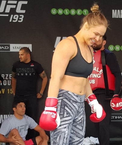 UFC women's bantamweight champion Ronda Rousey laughs during a workout Thursday at Federation Square in Melbourne, Australia, during open workouts for UFC 193 where she will defend the belt  ...