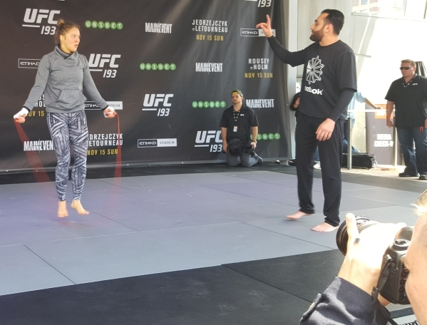 UFC women's bantamweight champion Ronda Rousey jumps rope during a workout with coach Edmond Tarverdyan Thursday at Federation Square in Melbourne, Australia, during open workouts for UFC 19 ...
