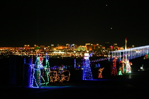 holiday lights are shown with the las vegas strip in the background during the