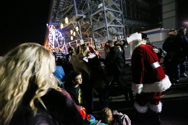A man dressed as Santa Claus greets attendees during the unveiling of Glittering Lights holiday drive-through light setup at Las Vegas Motor Speedway in Las Vegas on Thursday, Nov. 12, 2015. Chase ...