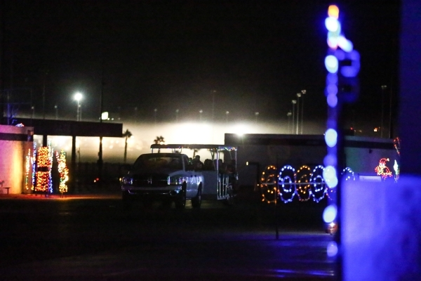 People ride on a trailer during the unveiling of Glittering Lights holiday drive-through light setup at Las Vegas Motor Speedway in Las Vegas on Thursday, Nov. 12, 2015. Chase Stevens/Las Vegas Re ...
