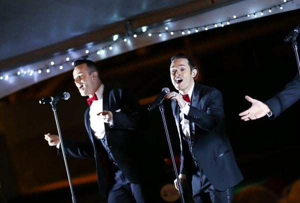 Members of Human Nature perform during the unveiling of Glittering Lights holiday drive-through light setup at Las Vegas Motor Speedway in Las Vegas on Thursday, Nov. 12, 2015. Chase Stevens/Las V ...