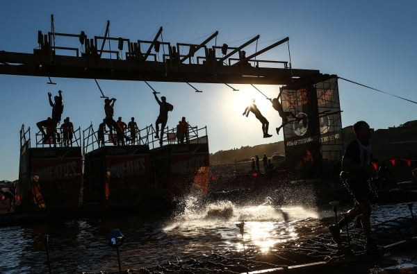 Competitor fly through the air at an obstacle course during the World's Toughest Mudder competition in Lake Las Vegas on Saturday, Nov. 14, 2015. Chase Stevens/Las Vegas Review-Journal Follo ...