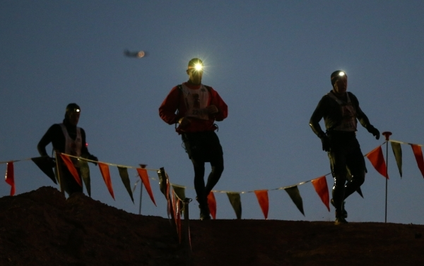 Competitors run the course during the World's Toughest Mudder competition in Lake Las Vegas on Saturday, Nov. 14, 2015. Chase Stevens/Las Vegas Review-Journal Follow @csstevensphoto